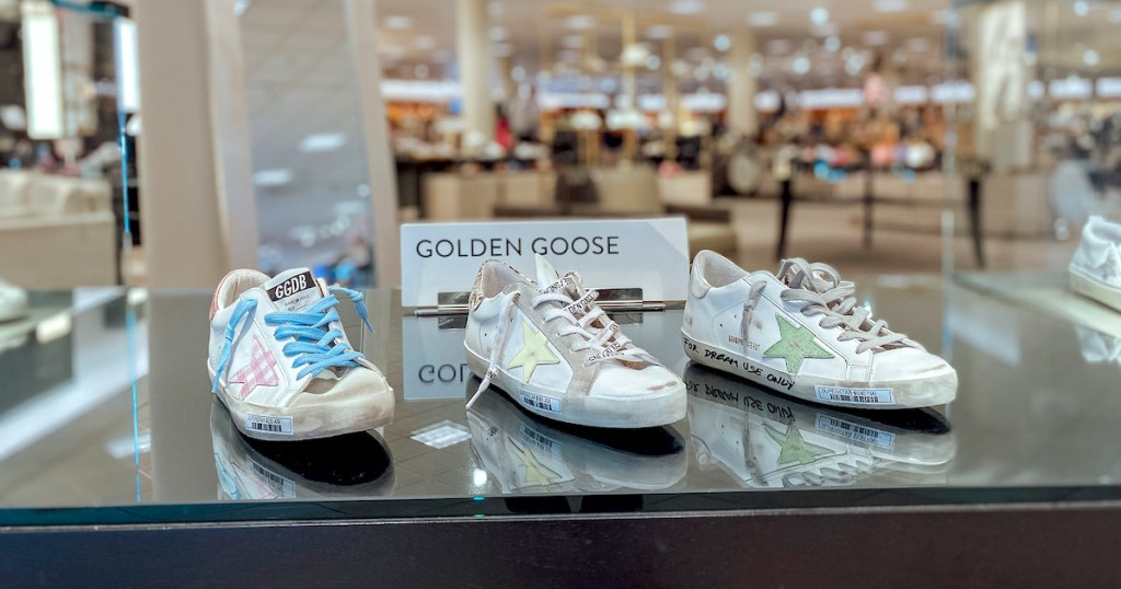 golden goose shoes on store display
