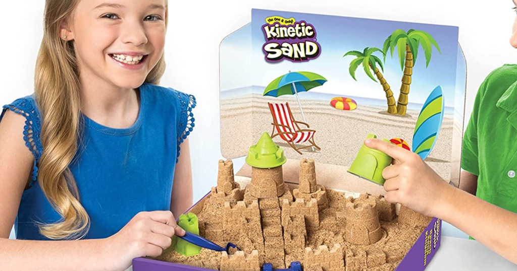 kids playing with a kinetic sand beach set