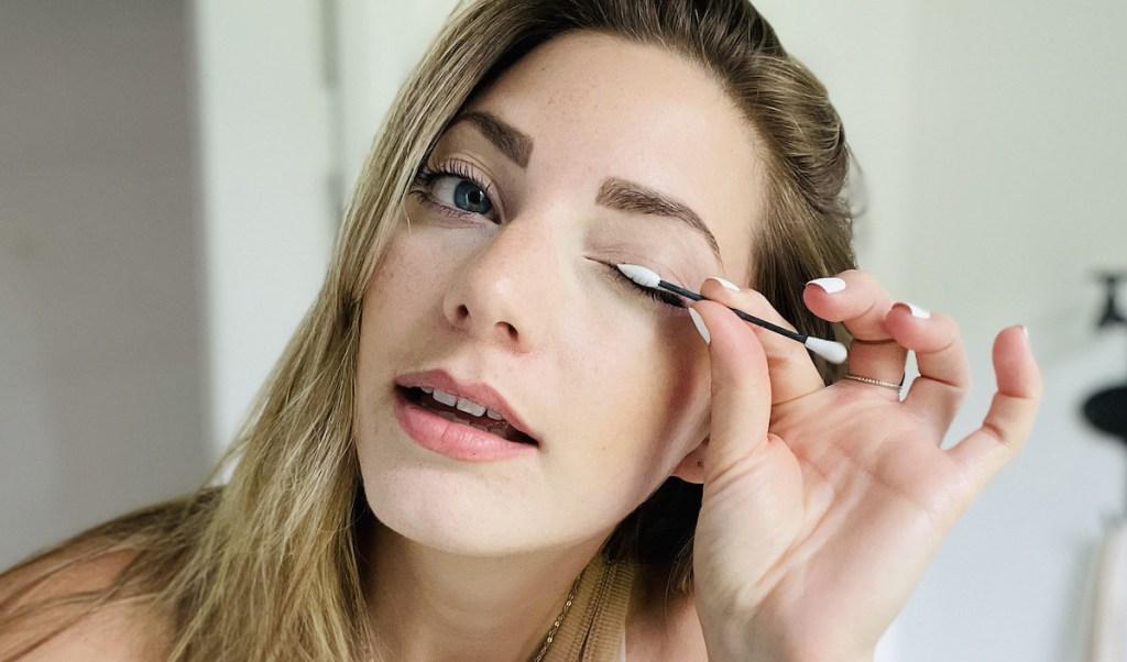 woman using reusable q tip on eyelid