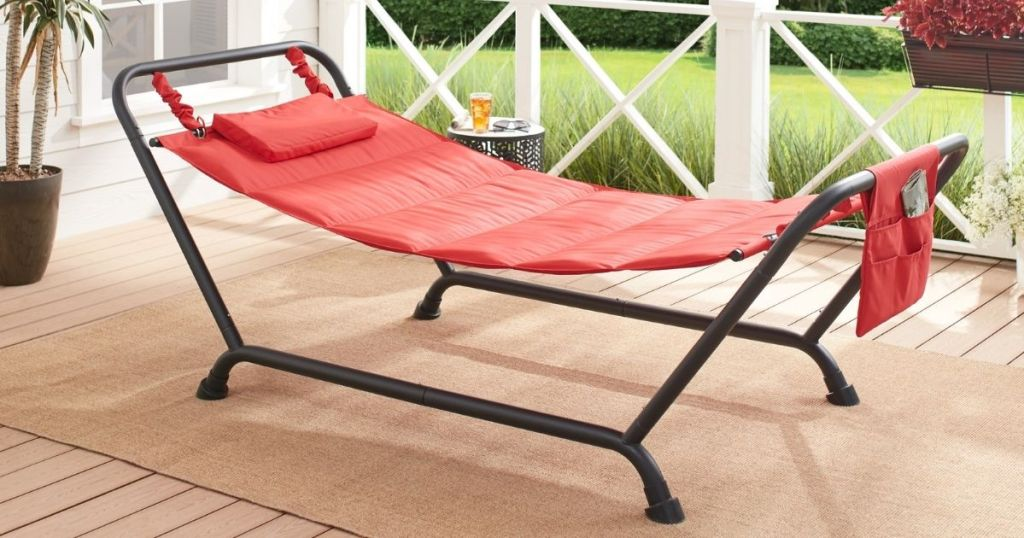 red hammock on stand on porch