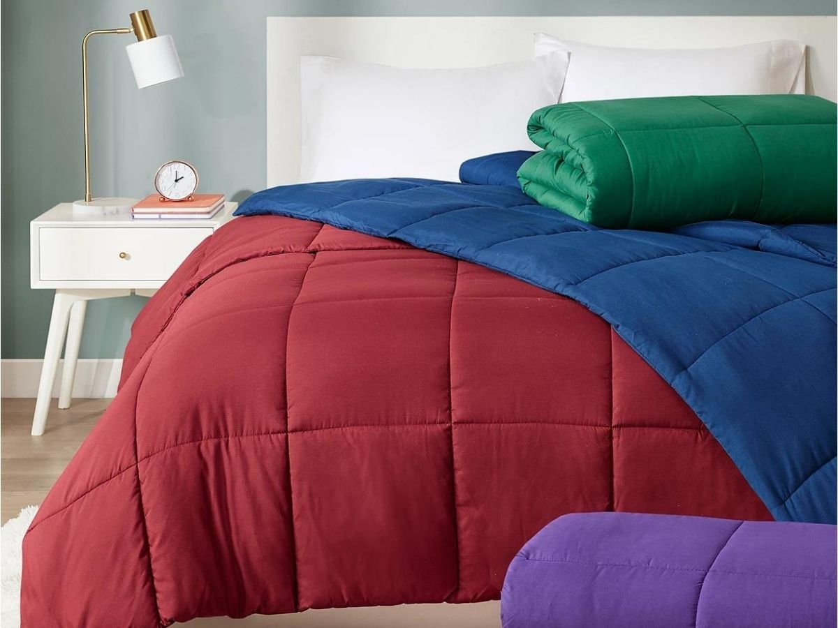 red blue and green comforters on bed