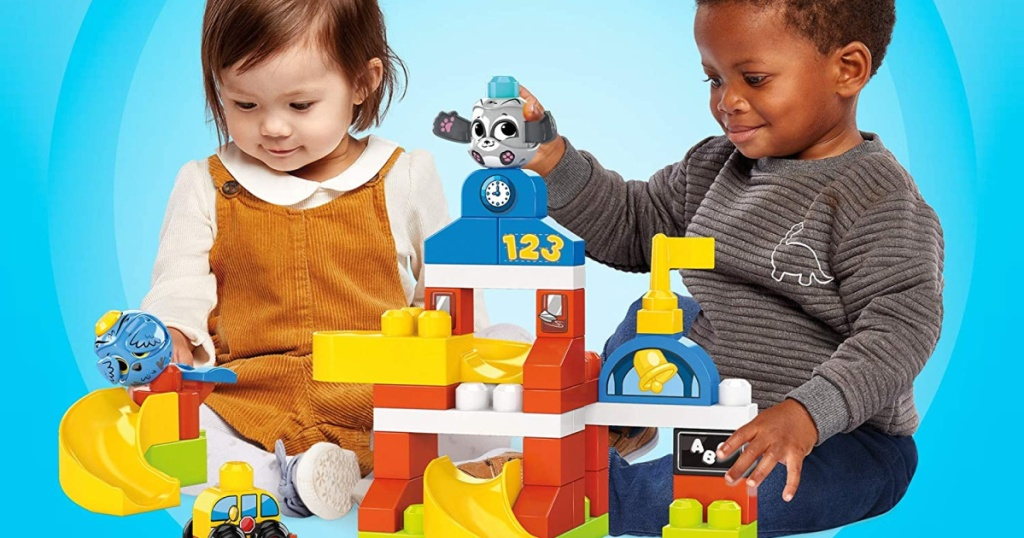 2 little toddlers playing with mega blocks