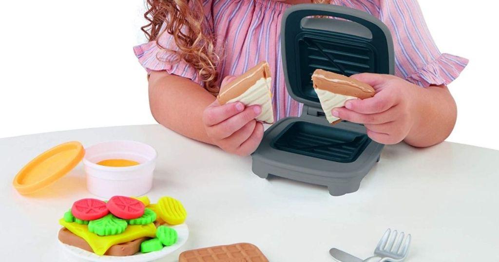 kid using sandwich maker play doh set