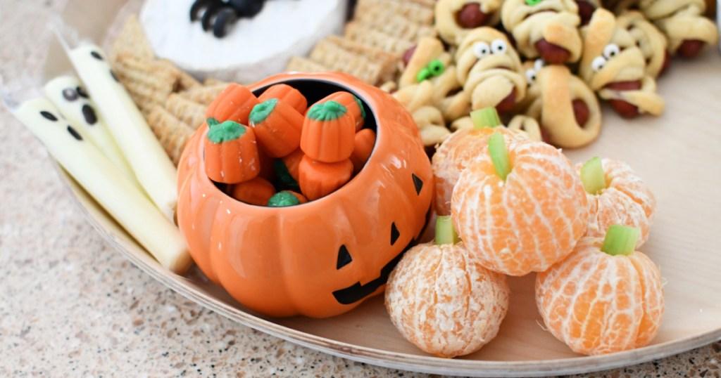 pumpkin with candy corn and mandarin orange pumpkins