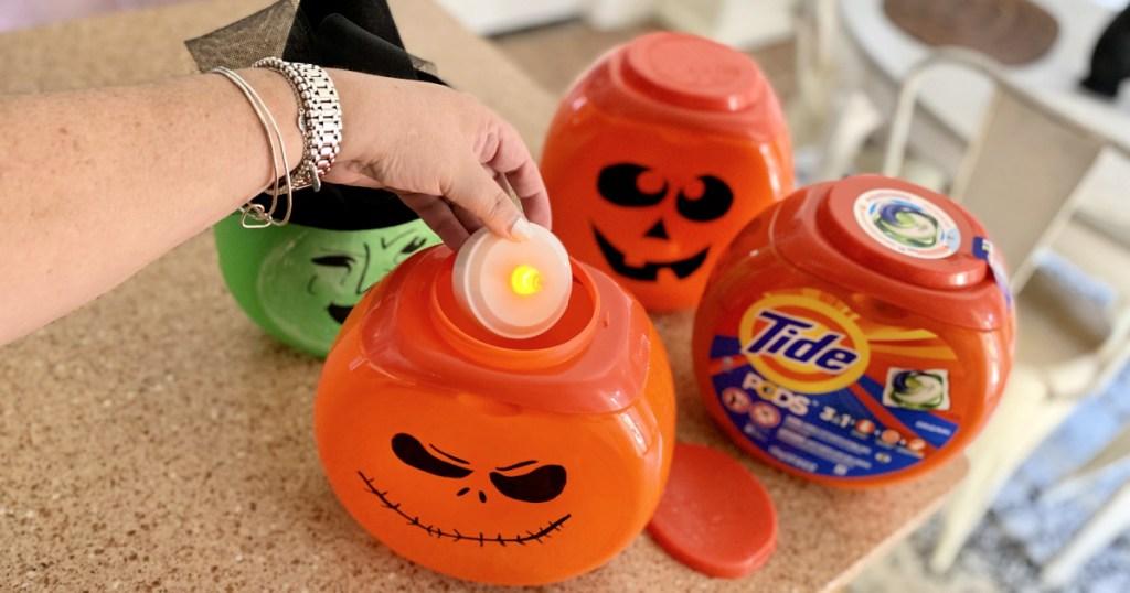 putting tea light inside tide pod container halloween decorations