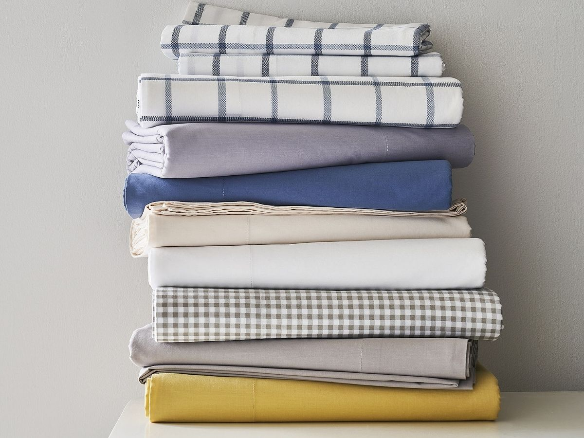 plaid and colored stack of sheets
