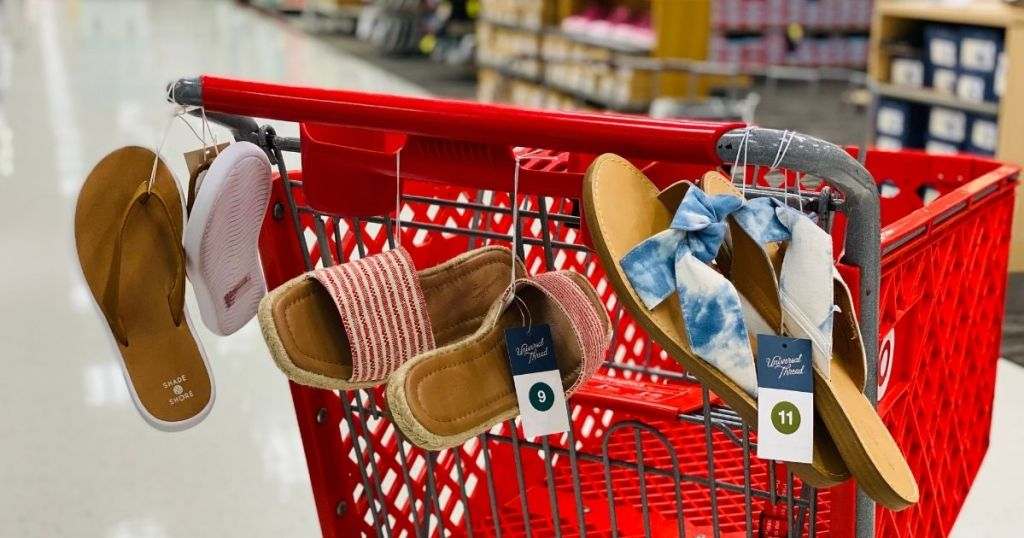 Target shopping cart with sandals hanging off the cart