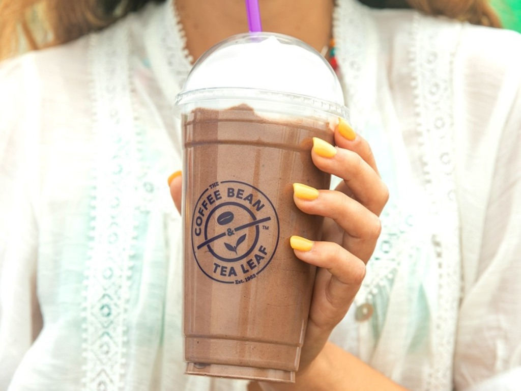 holding a frozen drink from the Coffee Bean & Tea Leaf