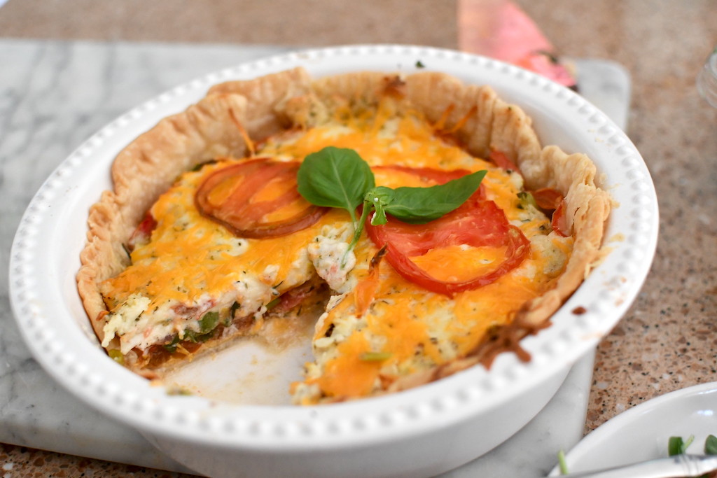 tomato pie with slice out of it