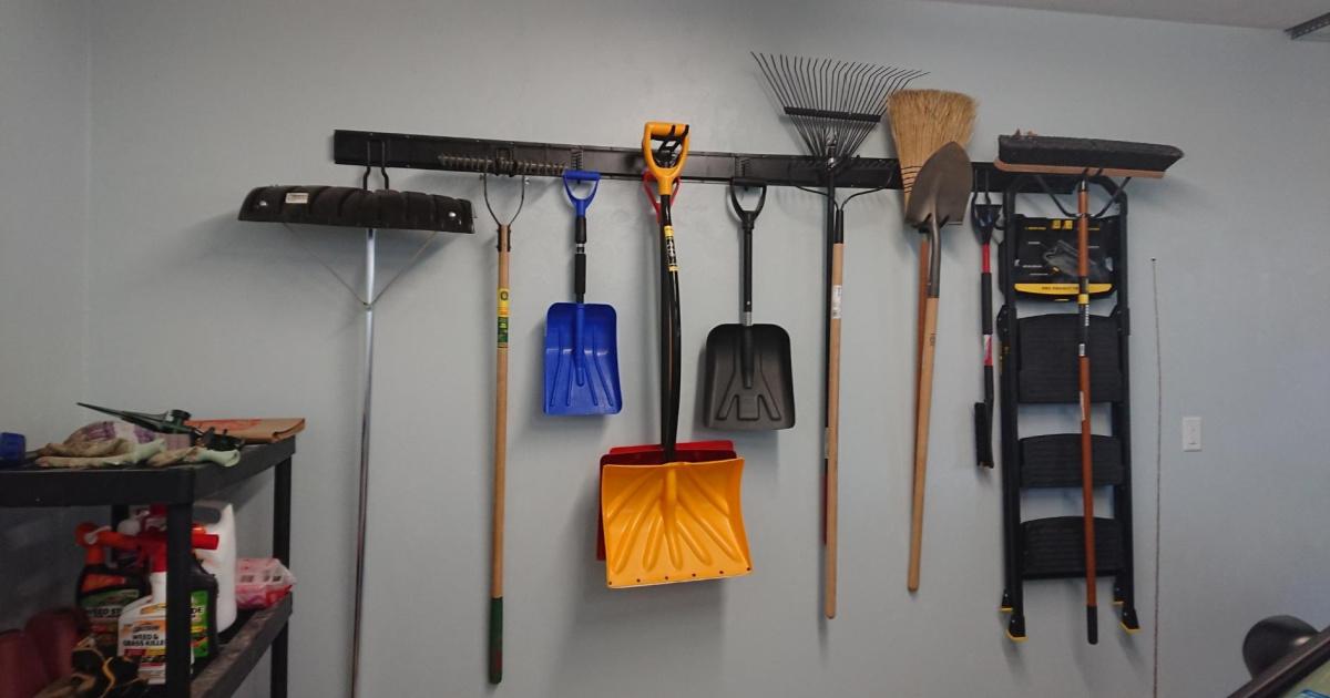 garage tools hung on a steel organizer