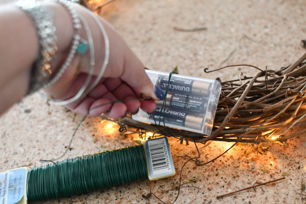using floral wire to attach fairy lights