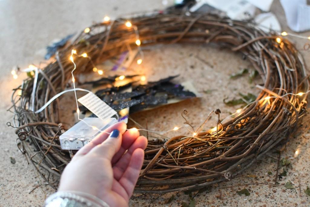 weaving fairy lights in a wreath