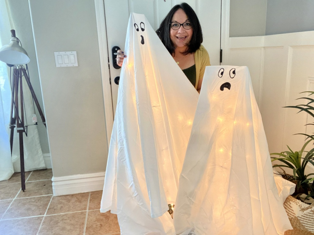 woman making tomato cage Halloween ghost decorations