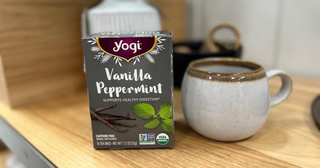 yogi teas next to mug
