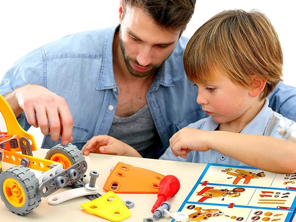 dad and son building 5-in-1 stem vehicle toy kit