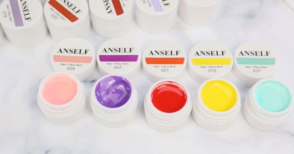 opened pots of gel nail polish