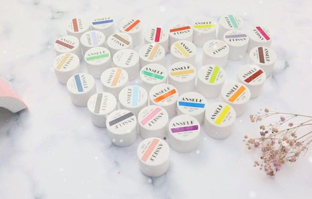 pots of gel polish arranged in heart shape