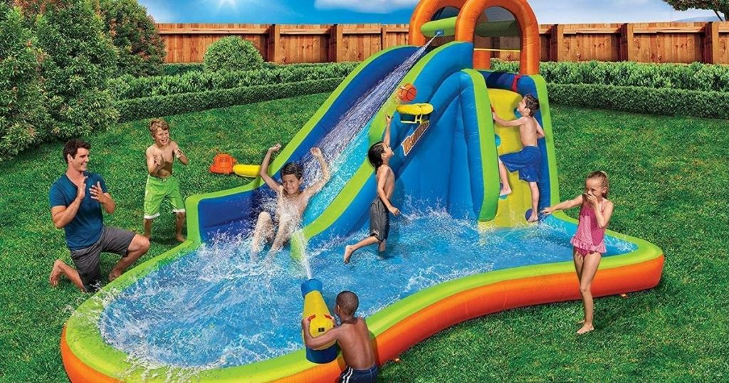 kids playing on an inflatable waterpark