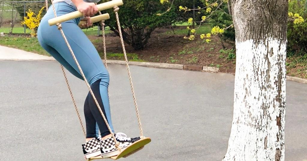 girl on bliss hammock skateboard swing