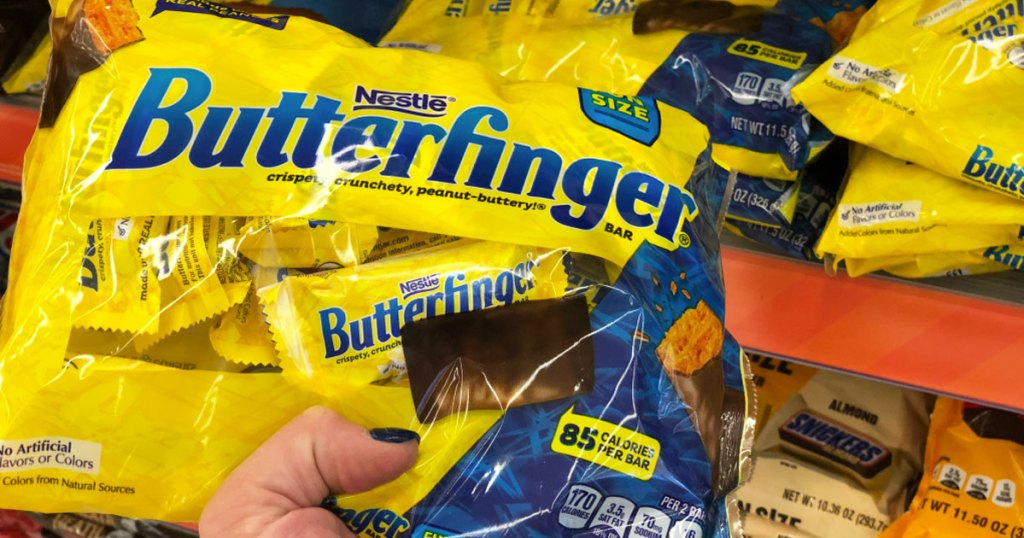 holding bag of butterfinger candy