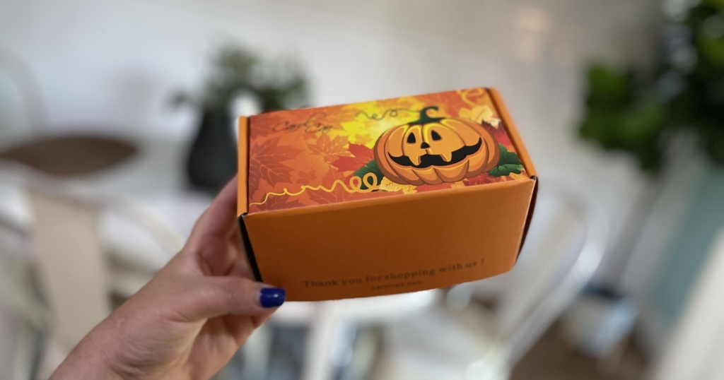 woman holding a halloween gift box