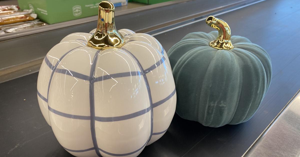 two ceramic pumpkins on conveyor belt