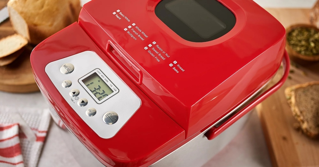Top view of a stainless steel breadmaker. The top is red and the sides are stainless