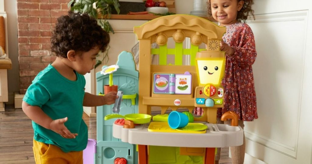 kids playing with a kitchen set
