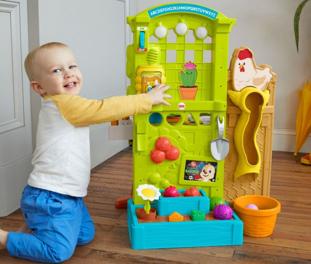 boy playing with a Fisher-Price Playset