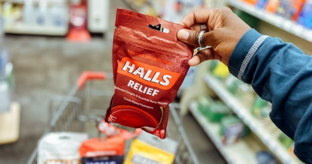 hand holding halls relief cough drops in store
