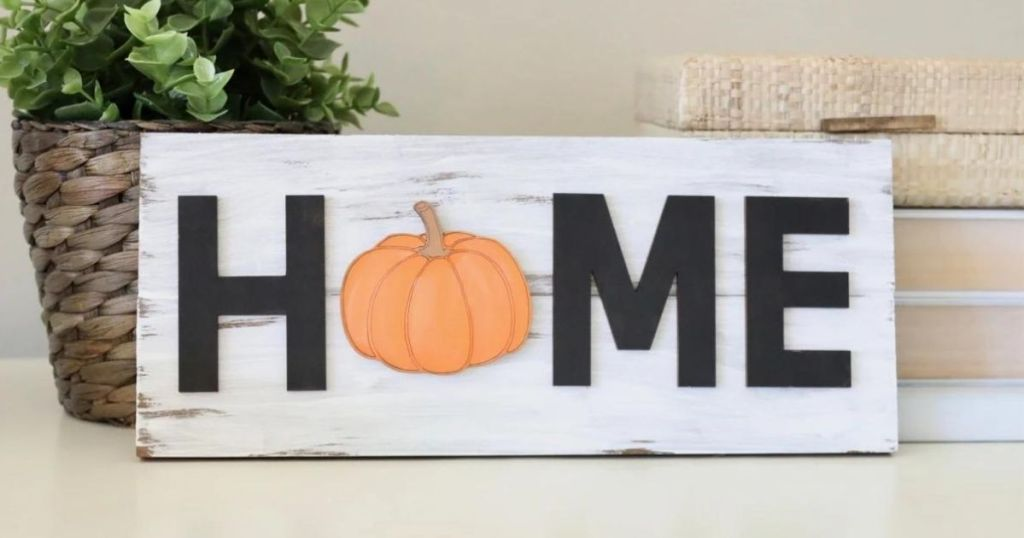 Home sign with a pumpkin for the O