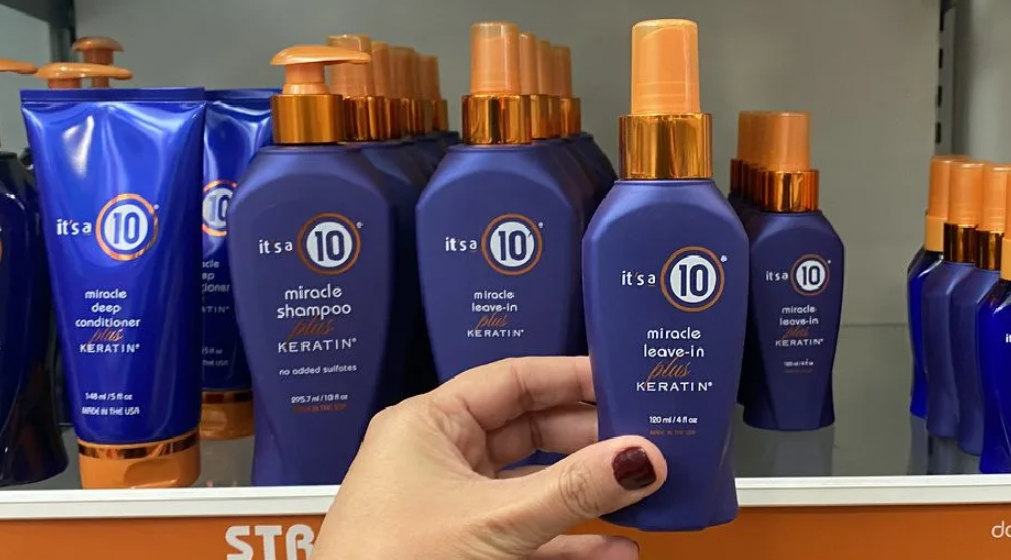 hand holding a bottle of It's a 10 Plus Keratin