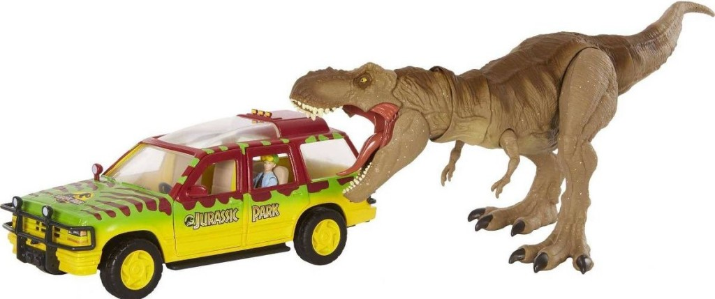 toy dinosaur eating a truck