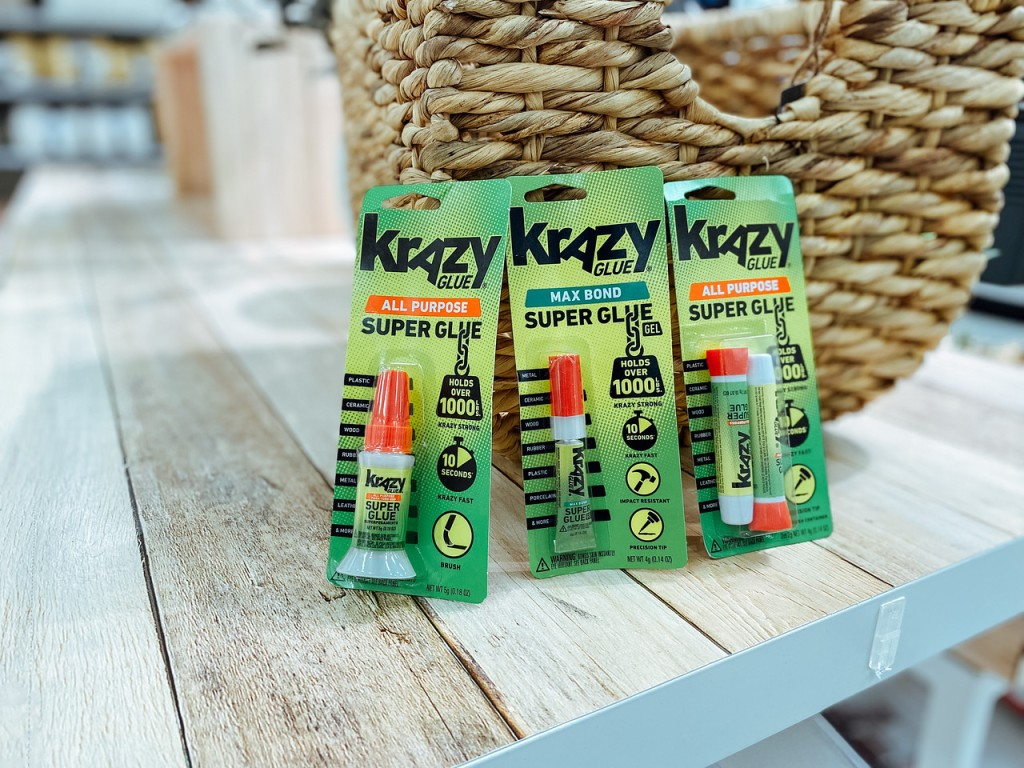 Krazy Glue packages on store shelf in front of basket