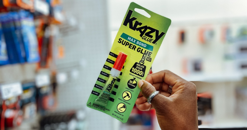 hand holding a package of Krazy Glue Max Bond