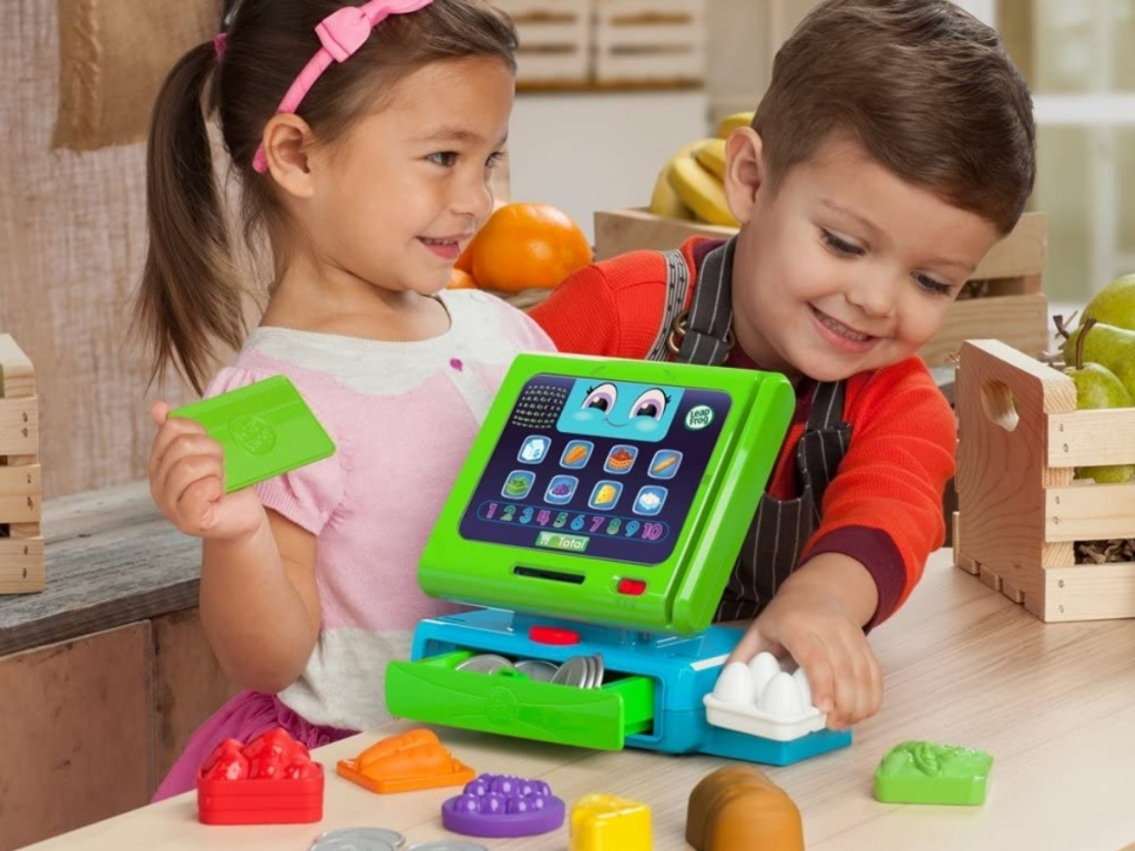kids playing with leapfrog cash register