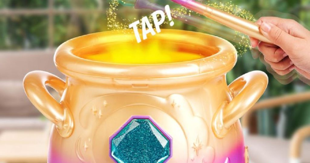 hand tapping toy gold cauldron