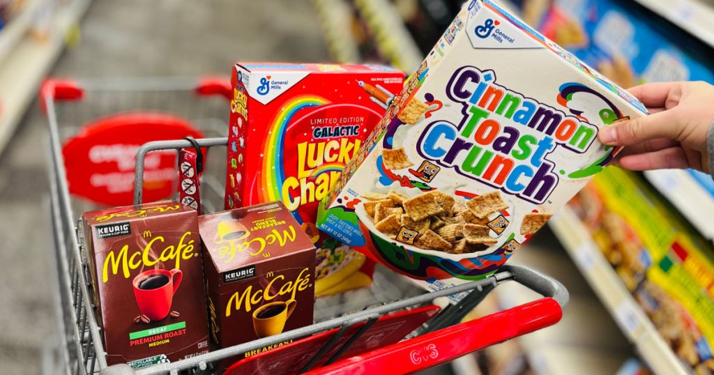 hand grabbing box of cereal from cart