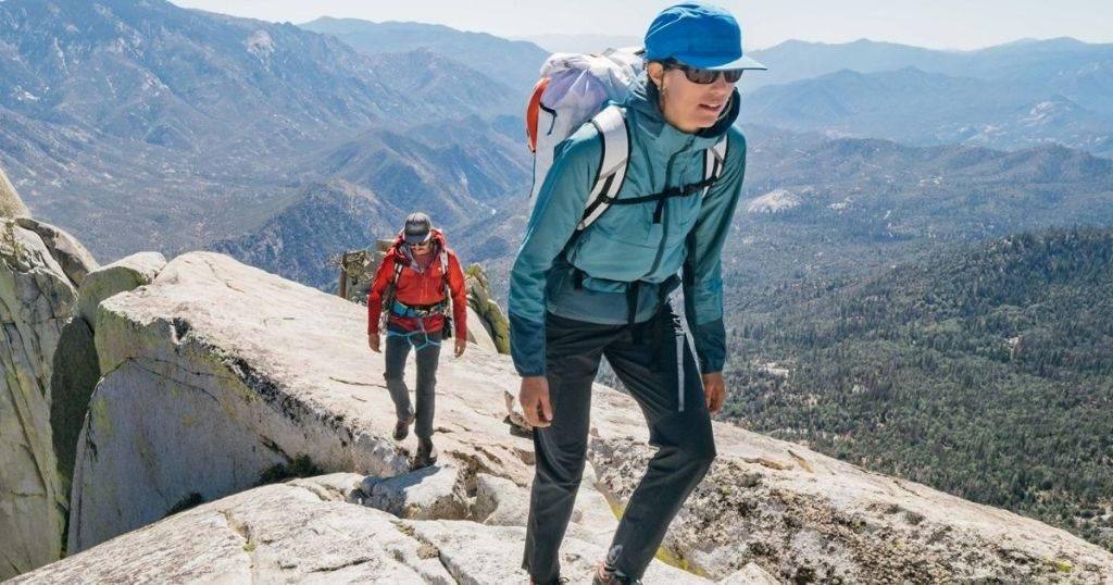 man and woman hiking on a mountain