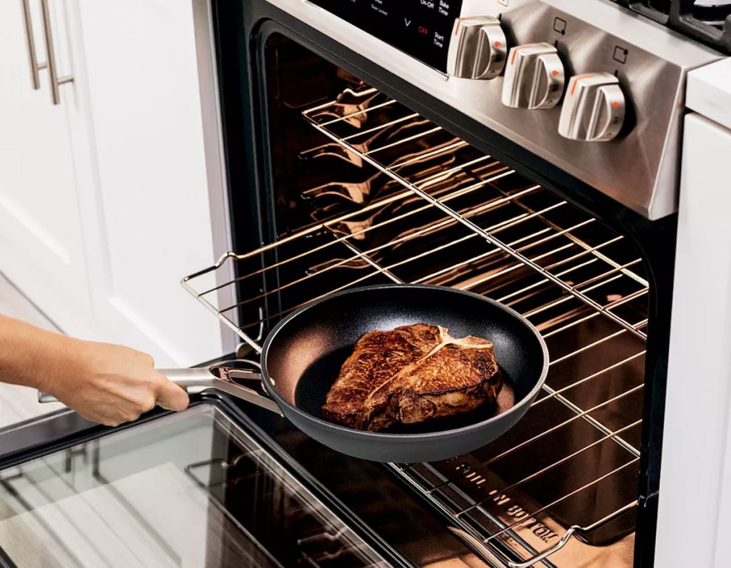 placing frying pan into oven