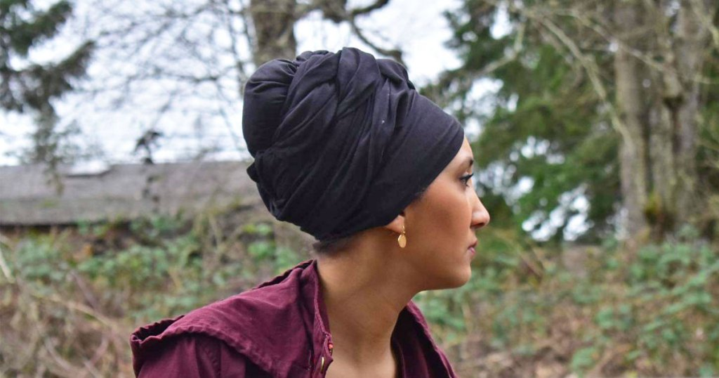 woman outside with black headwrap