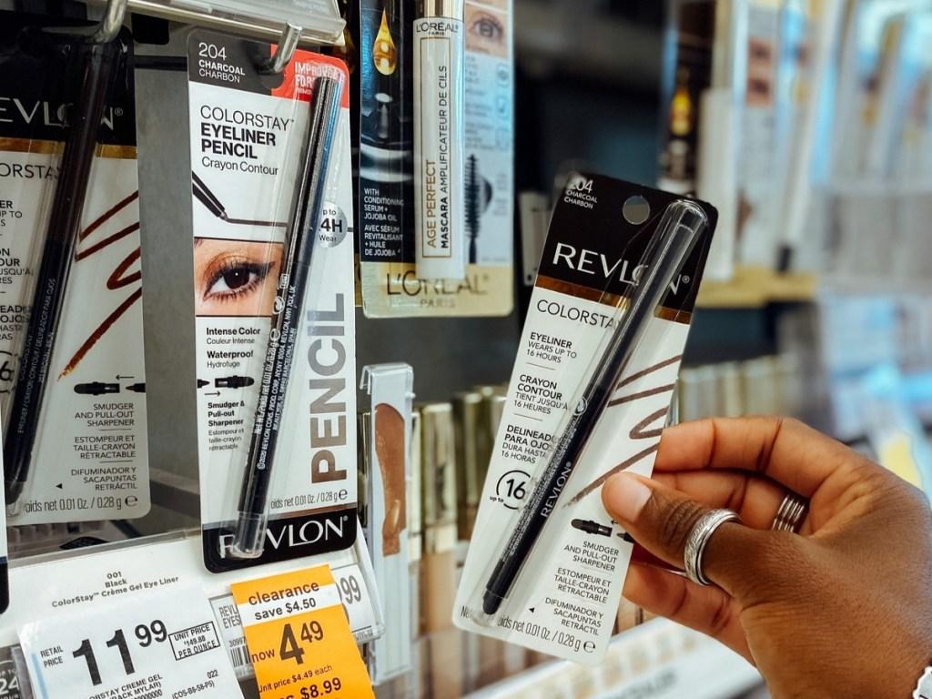 hand holding revlon colorstay eyeliner in store