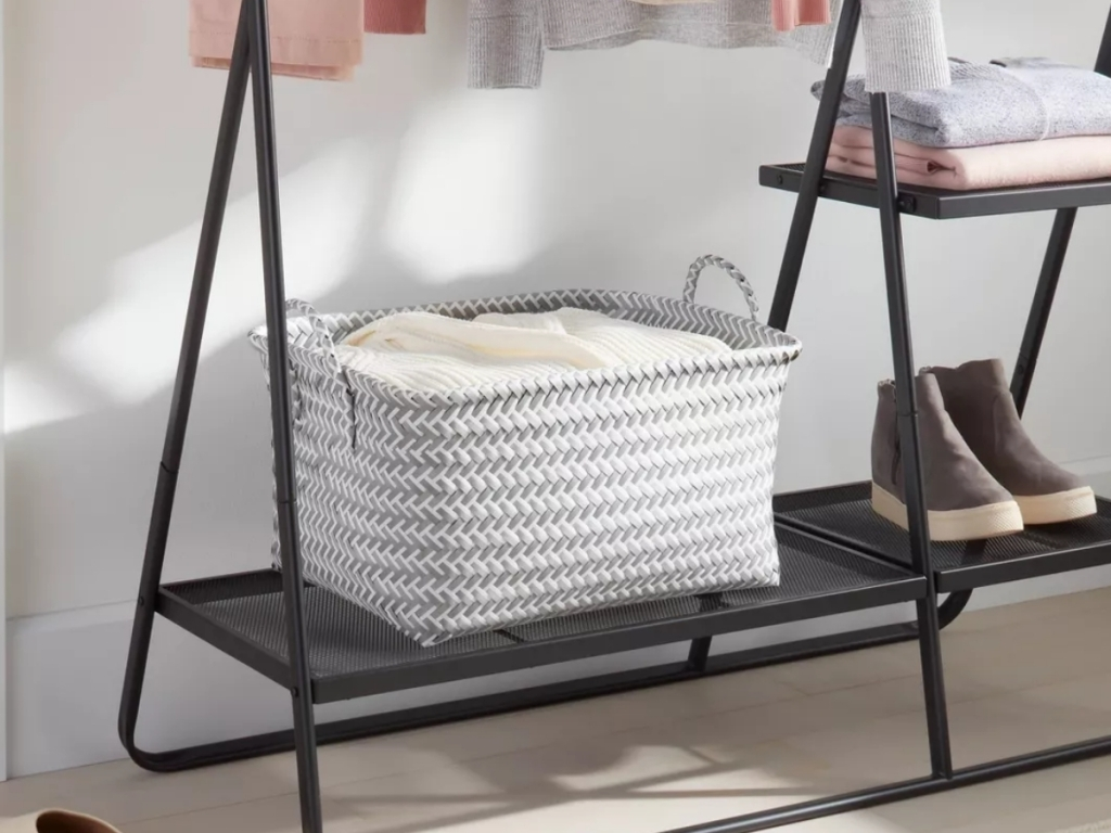 room essentials white and gray woven storage basket with clothes and shoes