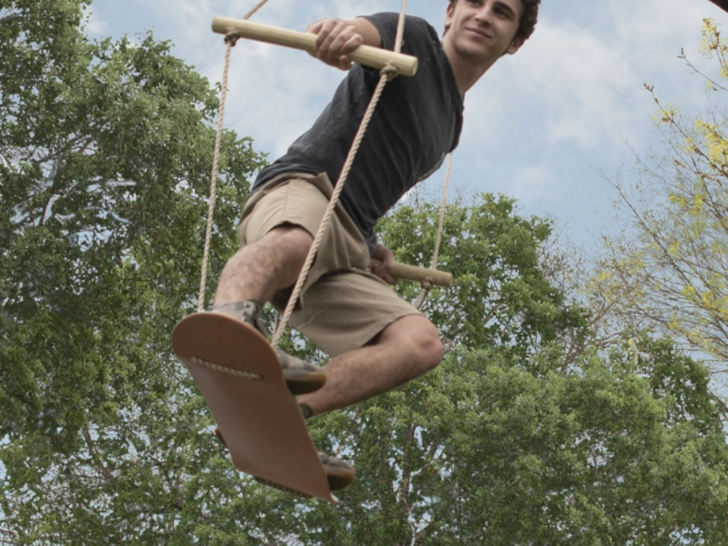 boy swinging on skateboard bliss hammock swing