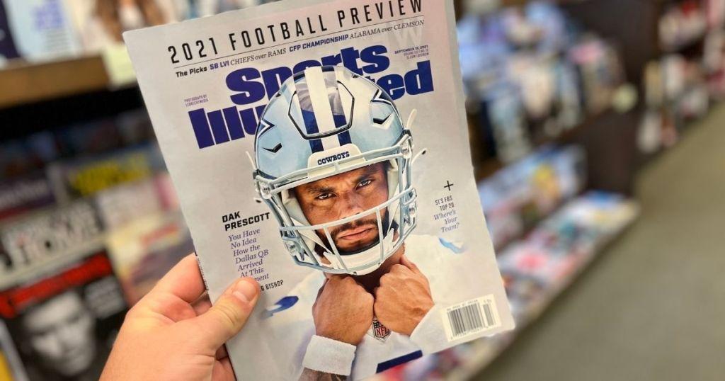 hand holding Sports Illustrated magazine