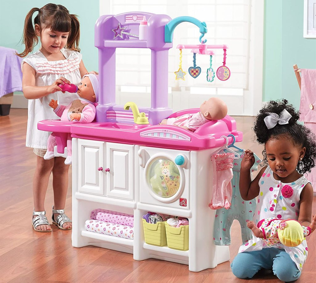 two girls playing with step2 nursery