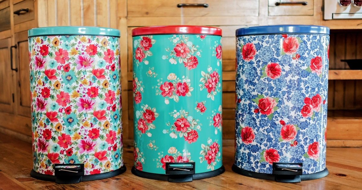 three different colored floral pioneer woman trash bins