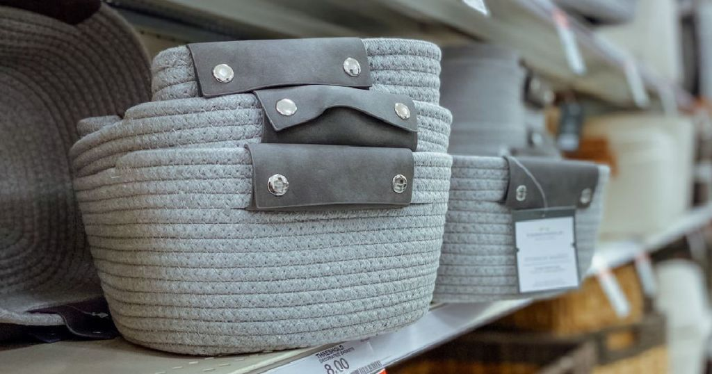 gray baskets on shelf