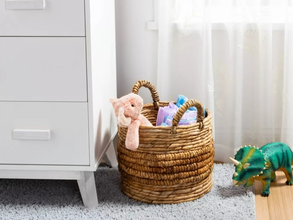 threshold natural round storage basket with toys in room
