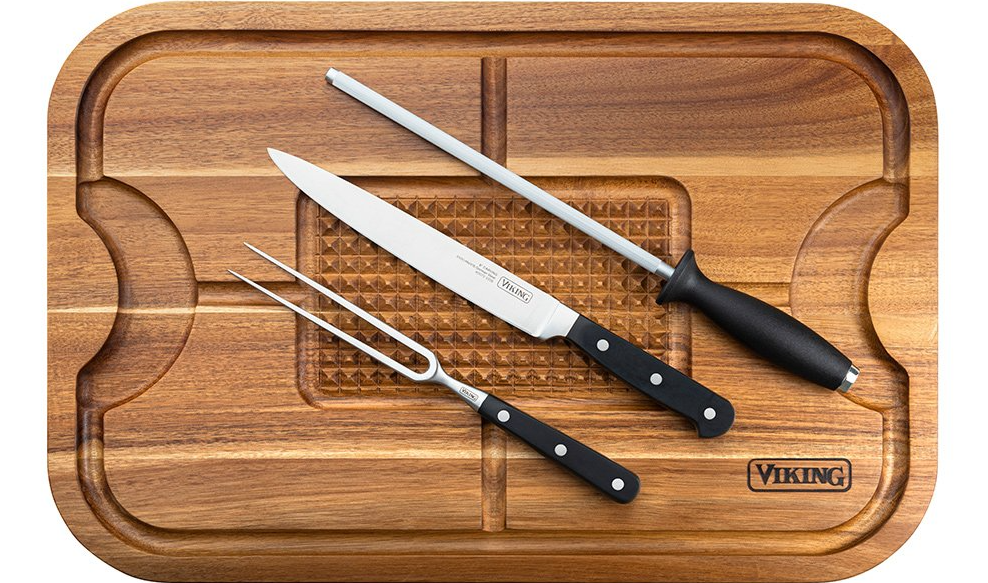 Viking cutting board with knives on it